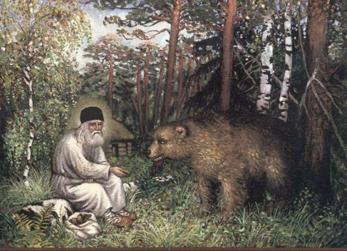 Lienzo del Santo alimentando a un oso.