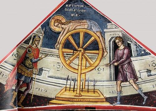 Santa Eufemia torturada en la rueda (que parece ser la de cuchillas, aunque en la passio constaba que era la de fuego). Fresco ortodoxo griego.