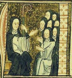 anta Hildegarda instruyendo a las monjas de su Abadía. Es la 4ª doctora de la Iglesia y la 6ª. de origen benedictino.