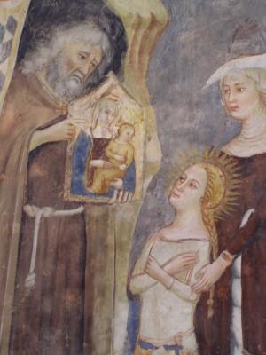 Otra versión de la leyenda: el ermitaño Ananías muestra a la Santa un icono de la Virgen con el Niño. Fresco gótico en S. Maria della Roca, Offida (Italia).