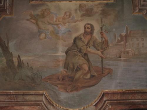 San Gerardo cruza el río sobre su manto.