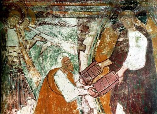 Dios entrega las Tablas de la Ley a Moisés. Mural románico.