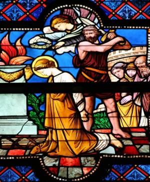 Detalle del martirio de Santa Eugenia en una vidriera decimonónica en la catedral de Brujas, Bélgica. Fotografía: Barryra.