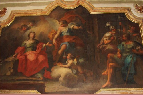 La Santa en la cárcel, alimentada con pan y vino por ángeles. Pintura de Gaspare Serenario en la Capilla de la Santa. Iglesia de San Francisco de Paula, Palermo (Italia).