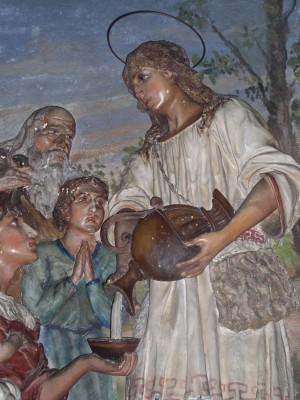 Relieve del Santo atendiendo a los pobres. Iglesia de la Inmaculada, Vergo Zoccorino (Italia).