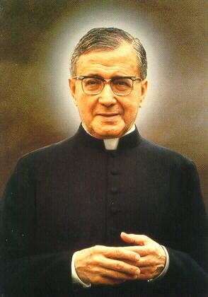 Fotografía del Santo, reproducida como estampa devocional.