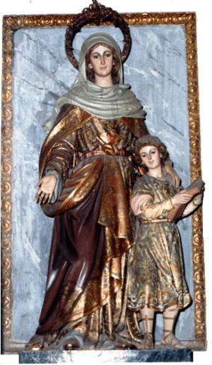 Imagen de la Santa con su hijo Agustín, todavía niño. Iglesia del Salvador y de Santa Mónica, Valencia (España).