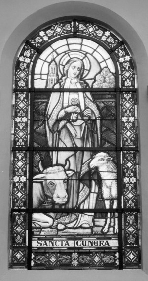 Santa Cunera, protectora del ganado. Vidriera decimonónica en la iglesia de San Miguel de Woudsend, Holanda.