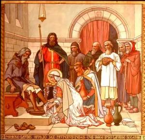 La Santa lavando los pies a los pobres. Pintura historicista en la iglesia de la Santa en Queensferry, Reino Unido.