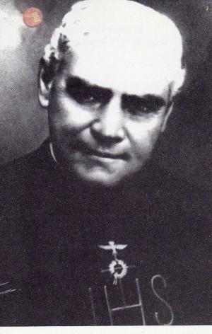 Fotografía del Venerable en una estampa con reliquia de tercera clase.