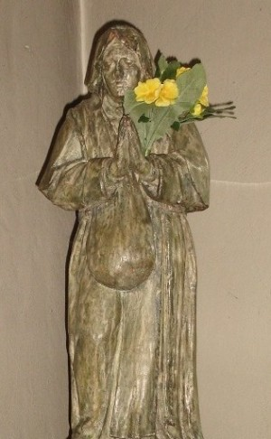 Estatua de la Beata en su capilla de Woluwe, en su iconografía más habitual: portando su alforja para limosnas.