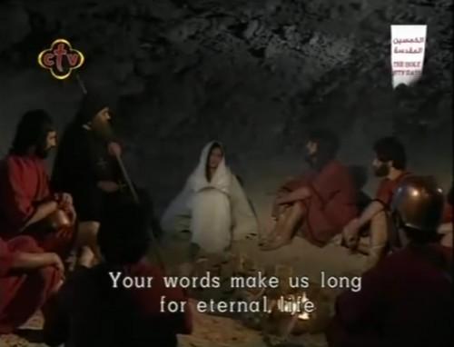 Escena de la película copta: el ermitaño Mateo instruye a Behnam, Sara y los 40 soldados en la fe cristiana.
