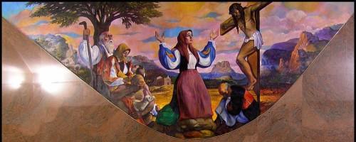 Mural contemporáneo de la Beata en adoración ante Jesús Crucificado. Parroquia de Orgosolo, Cerdeña.