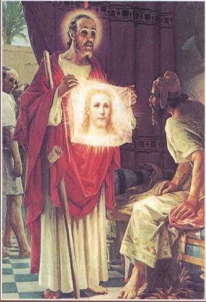 El Santo mostrando la imagen de Cristo. Estampa devocional.