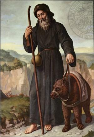 San Romedio y el oso. Santuario de San Romedio en Coredo (Italia).
