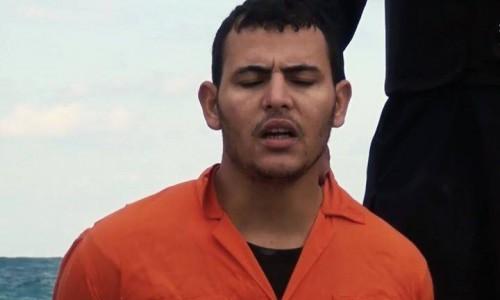 Instantánea de uno de los mártires pronunciando el nombre de Jesús antes de morir.