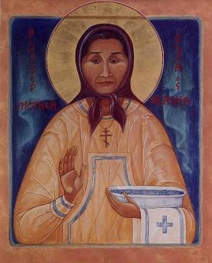 Icono de Santa Olga Michael con los atributos de una comadrona.