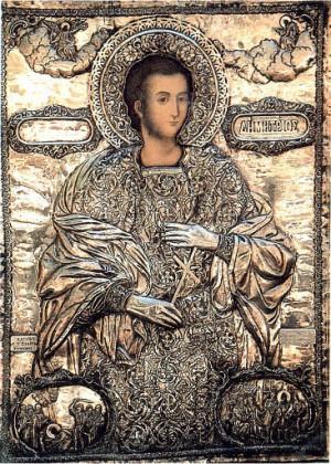 Icono ortodoxo griego del Santo recubierto en plata.