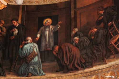 El Santo predicando a los hombres.