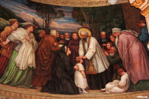 El Santo bendiciendo a los niños.